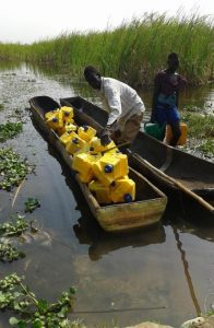 LifeSaver Cube water purifiers South Sudan transported on canoe