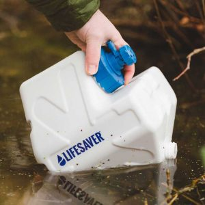 LifeSaver Cube being used to filter river water