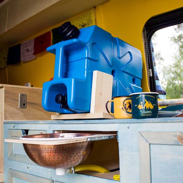 LifeSaver water purifier Jerrycan on a shelf in an overlanding or vanlife vehicle