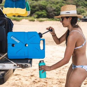 Woman using LifeSaver Jerrycan to fill bottle with clean water from an overlander vehicle