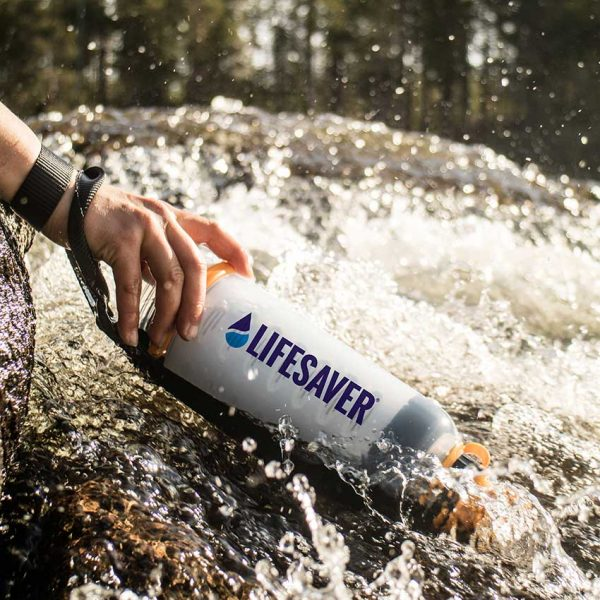 LifeSaver water purifier bottle being used to filter moving river water