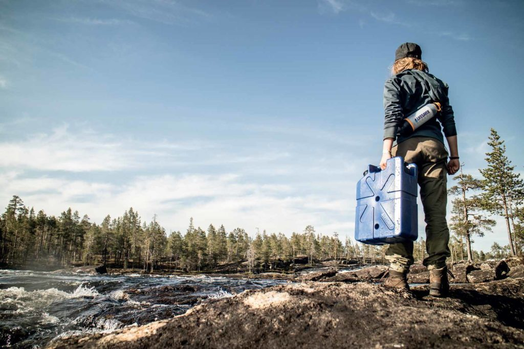 Survivalist or outdoor enthusiast with water purification products