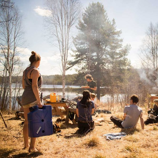 Group of people camping using the LifeSaver water purification Jerrycan for clean water