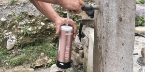 The LifeSaver Liberty Rose Gold being filled with tap water in Nepal